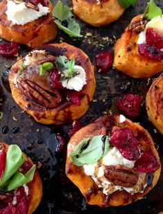 Sweet Potato Rounds with Goat Cheese Appetizers, with Cranberries & Honey Balsamic Glaze, finished with a blood orange infused olive oil.