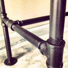 "DIY galvanized steel pipe desk frame detail. 1"" pipe with 2 coats of metal primer / 2 coats of rustoleum oil rubbed bronze spray paint / 2 coats of rustoleum matte finish spray."