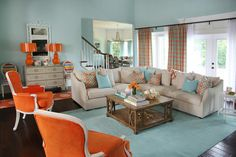 HGTV presents a living room that was inspired by the client's favorite colors, orange and aqua, to produce a cheerful atmosphere.