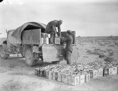 The Italian Offensive 1940 - 1941: Cans of water, a vital factor in desert warfare, are loaded onto a lorry to be transported to British forward positions at Bardia.
