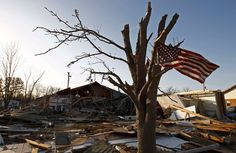 flag blows in the wind as it hangs from a tree overlooking the damage caused by a tornado in Harrisburg, Illinois on March (Jim Young/Reuters) # Wind Damage, Blowin' In The Wind, Trail Of Tears, Photojournalism, Image Shows, Flag, Harrisburg Illinois, Photo And Video, World