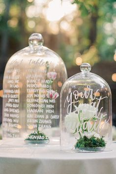 "From the editorial ""Here's Proof That Intimate Weddings Are Just as Breathtaking as Lavish Affairs."" Dusty pinks, whites, and lush greens were their floral vision and just wait until you see their escort card display!  LBB Photography: @amyarringtonphotography Calligraphy: @peachandvalley  #weddingcalligraphy #weddingescortdisplay #escortcarddisplay #weddingseatingidea"