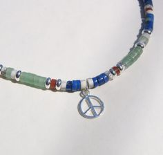Peace Heishi Silver Charm Red Green Blue Lapis Choker Necklace, via Etsy.