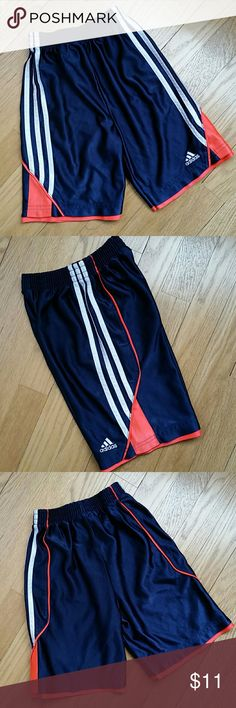Size 7 boy Adidas shorts Size 7 boys Adidas speed shorts. * In good used condition. No stains, holes, or marks, but there are some minor pulls in fabric. Pulls aren't noticeable when the shorts are on. * 100% polyester. Midweight material, so pretty sturdy. * Navy blue with white and orange accents. * Approx 6 inch inseam; 14 inch outseam.  ** Price is firm unless bundled with something else from my closet. See my closet for more great kids and women's items. Make a bundle and get a…