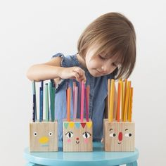 These easy and silly Pencil Holder Heads can be made by drilling a few holes into a simple block of wood and some painted faces!