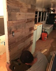 @punkrunner69 installing pallet wall. We are sooo close to the finish line! All we got is Propane hookup and flooring.