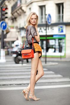 Fall 2012 Couture Street Style: Balenciaga shorts, Valentino shoes, Proenza bag and legs for days on Hanne Gaby Odiele.
