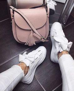 White sneakers, white jeans, white fishnet tights, blush saddle bag, tassel