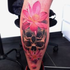 A skulls and flowers tattoo piece by artist Alex de Pase.   Intenze ink
