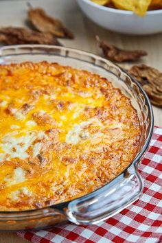 Baked Taco Dip - Prepared with taco-seasoned ground beef, cream cheese, sour cream, mayonnaise, salsa, cheddar cheese and Jack cheese.