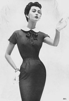Dovima May 1954  Dovima modeling a Mollie Parnis sheath dress in American Vogue, May 1954