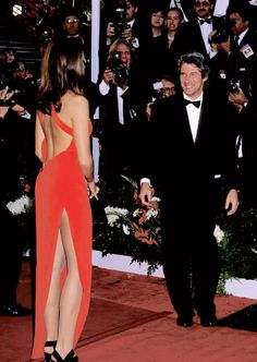 1991 Oscars - with then boyfriend Richard Gere, supermodel Cindy Crawford cause a stir in a scarlett red Versace gown with a super high slit - which has since been copied and made more even more daring today.