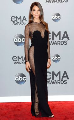 OW OW! Lily Aldridge absolutely slays us in this super sexy black illusion-paneled gown.