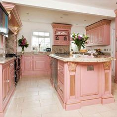beautiful PINK cabinetry....needs some wallpaper to pull it together...love this!