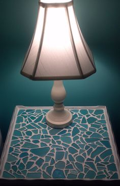 Sea Glass Mosaic Table. Took an old table, spray-painted it white, used a clear glass adhesive and glued down my sea glass (Michael's), and used pre-mixed grout (Michael's). Simple and matches my bedroom walls!