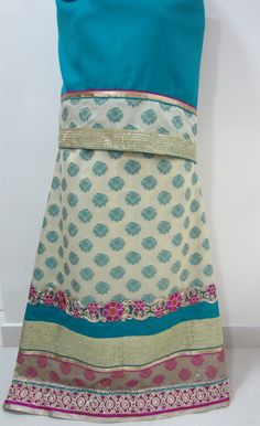 Description - Vanilla cream colored rida with woven motifs all over lehenga, designed using a contrast pine green colored pardi along with pink pearl lace, gold sequined lace and floral dori work lace for a simple yet outstanding look. INR. 1900/-