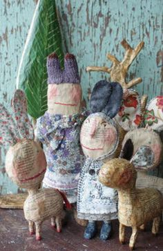 "A group shot of village inhabitants A Running Away Rabbit – rolling along on movable wheels   A shelf of lovelies   I'm captivated by Julie Arkell's original and whimsical papier-mâché and mixed media creations. One of England's best recognized contemporary folk artists – It has been said that she ""…cannot resist the rejected debris of …"