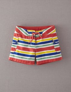 Striped girl surf shorts. Would look great paired with a plain rash guard (they don't have a matching one, but lots of other brands sell them). From mini Boden, sizes 2-12.
