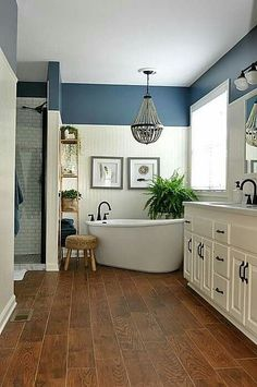 Love the woodgrain Ceramic tiles!! Low the height of the bead board and the corner tub and decor!