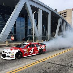 The picture of Kevin Harvick in the Budweiser Chevrolet SS doing a #Burnout outside Phillips Arena in #Atlanta #Padgram @stewarthaasracing