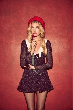 Model Elsa Hosk wears the Bianca mini dress from For Love & Lemons' holiday 2016 collection