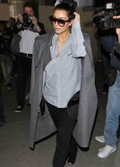 Kim Kardashian     Love the shades and the coat