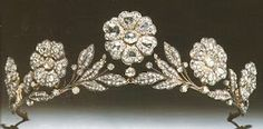This is the Strathmore Rose Tiara. Lady Elizabeth Bowes-Lyon (the future Queen Elizabeth, the Queen Mother) received it as a gift from her father, the Earl of Strathmore, for her wedding in 1923. The piece itself is likely older than that; it may have already been an antique when the Earl purchased it. The tiara features a garland of wild roses in diamonds mounted in silver and gold.