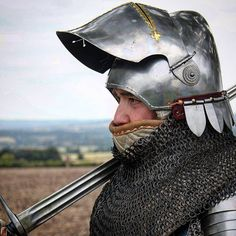 An armoured soldier takes a few moments.  #deedsofarms #bascinet #visor #armour #armor #soldier #medieval #middleages #14thcentury #reenactment #history Knihht medieval armor 14th century harness fight porn reenactor
