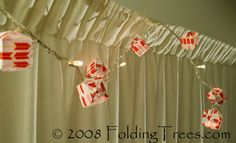 Super cute tute for making balloon lights out of a string of twinkle lights and scrapbooking paper.