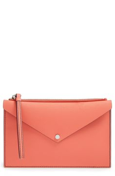 This ultraslim peach-hued Marc Jacobs bag is as versatile as it is chic:  it could be worn as a pouch, clutch, or a wristlet—and is is ideal for holding the day's essentials.