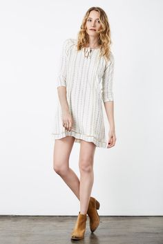 Relaxed Print Chic Peasant Tunic Dress | Soul Escape Let your worries fall to the wayside with a comfortable dress that can double as a poolside cover up or a casual day dress, featuring a peasant-style tie neckline and ¾ sleeves.
