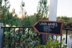 Purchased this sign from www.save-on-crafts.com & used it at our wedding to show guests where the lawn games were!  Photo by Buck Deitz Photography http://www.buckdeitzphotography.com/