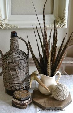 Pheasant Feather Floral Arrangement — In keeping with a neutral palette, Kathleen from Faded Charm Cottage has put pheasant feathers in a white pitcher and placed other natural elements around it.