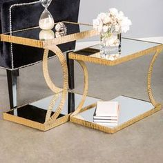 A stylish canvas for fresh bouquets or your after-work cocktail, this chic table brings a contemporary touch to your d�cor.Product: Small and large side tableConstruction Material: Iron and glassColor: GoldFeatures: Eye-catching designDimensions: 20 H x 13.5 W x 22.5 D (large)
