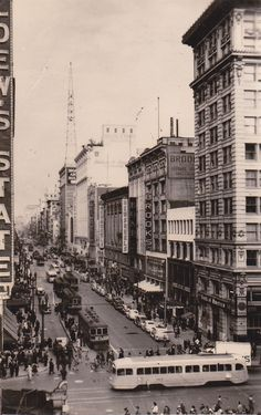"""Photograph from the intersection of Broadway and Seventh Streets, looking north. """"Murder at Eastern Columbia,"""" a James Murray mystery, by Christopher Geoffrey McPherson. [Downtown Los Angeles, probably 1940s.]"""