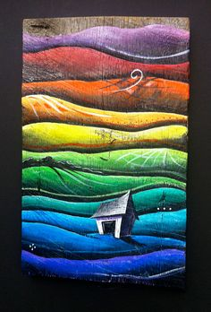 A Small Painting of a Barn with Rolling Colorful Hills on Reclaimed Barn Wood