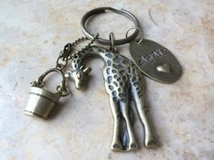 Hey, I found this really awesome Etsy listing at http://www.etsy.com/listing/102308345/brass-bronze-giraffe-charm-drinking