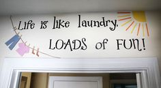 How cute is this?  I never thought about actually decorating the laundry room!