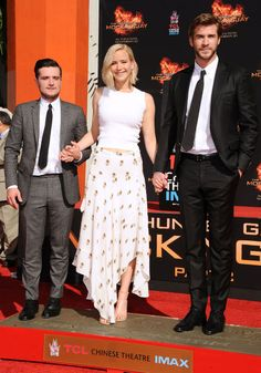 In A.L.C. with Josh Hutcherson and Liam Hemsworth at The Hunger Games - Mockingjay Part 2 hand and footprint ceremony in Hollywood.