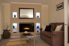 Feature chimney breast with recessed, illuminated alcoves. Brick Chimney Breast, Luxury Mobile Homes, Fireplace Fronts, Open Plan Apartment, Floor Plan Layout, Contemporary Style Homes, Lodge Style, Park Homes, Small Rooms