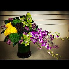 #WOW! Green cymbidium and purple dendrobium orchids with roses, green trick and wax flower. From our Callingwood store!