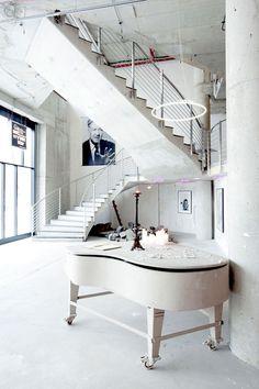Minimalist modern white interiors, grand piano; The NHow Hotel in Berlin, Germany