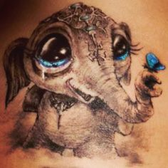 Baby elephant with butterfly tattoo