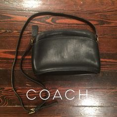 """Vintage Authentic Coach Crossbody Handbag Black leather vintage Coach handbag. Exterior has 1 slip pocket on the outside. Coach creed stamped inside and 1 spacious zipper pocket and brass zipper closure on top. Interior has the classic unfinished leather. All the leather and piping show very little wear. Clean inside and out. Please keep in mind that this bag is 20+ yrs. old, not new, and may show signs of use and age.  Long  shoulder strap has a drop from about 22""""-23"""". This strap is…"""