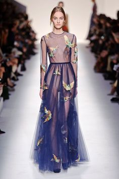 Valentino Valentino And then the duo just pulled out the pretty stops. Gown after gown (a dizzying number, actually) came out in some iteration of diaphanous chiffon and tulle layers with such fine details of birds, butterflies and woodsy scenes delicately appliquéd, beaded and embroidered in. It was a garden of delights.