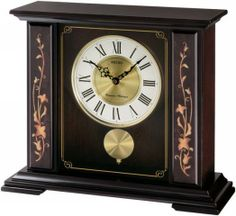mantel clock w/pendulum, dark brown wooden case with floral accents, glass crystal, Westminster/Shittington chime round two-tone dial, roman numerals