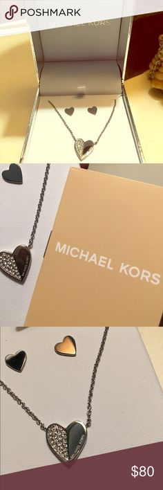 Brand New Michael Kors Silver Jewerly Set Brand New in box Silver Michael Kors heart Jewerly Set. Delicated and it has little rhinestones and it's super classy. KORS Michael Kors Jewelry Necklaces
