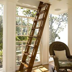 Instead of a bulky flight of stairs leading to tower's observation room – which would have blocked prime views of the bay – a slender, mahogany ship's ladder ascends from the master sitting area.