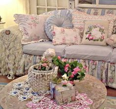 What a beautiful and cosy and perfect looking shabby chic sofa for curling up on with a good book and happily dreaming the hours away