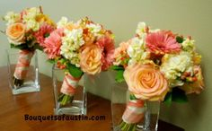 gerbera daisies with stock,hypericum berries, ambience roses, and apricot parrot tulips. (Bouquets of Austin TX)